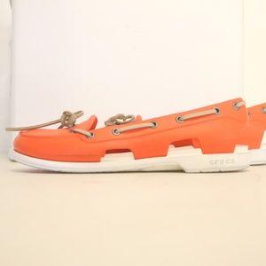 Crocs Women's 7 Orange and White Boat Shoes